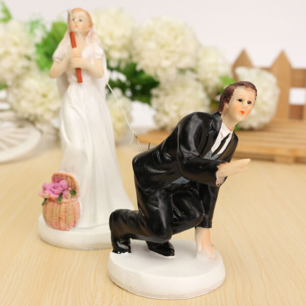 This statue is crafted of durable resin with a cute design that will put a smile on your face and a touch of romance on your wedding cake.