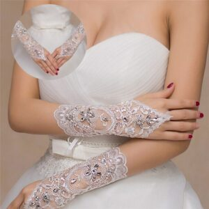 Everything you touch with this glove is dreamy and soft. Exquisite white gloves with flower pattern and embroidered crystals.