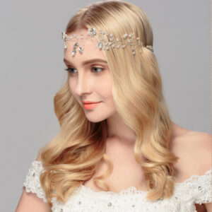 Elegant and delicate bridal wreath made by hand with the best import crystals and pearls. It has metal flowers with crystals that shine throughout the branch.