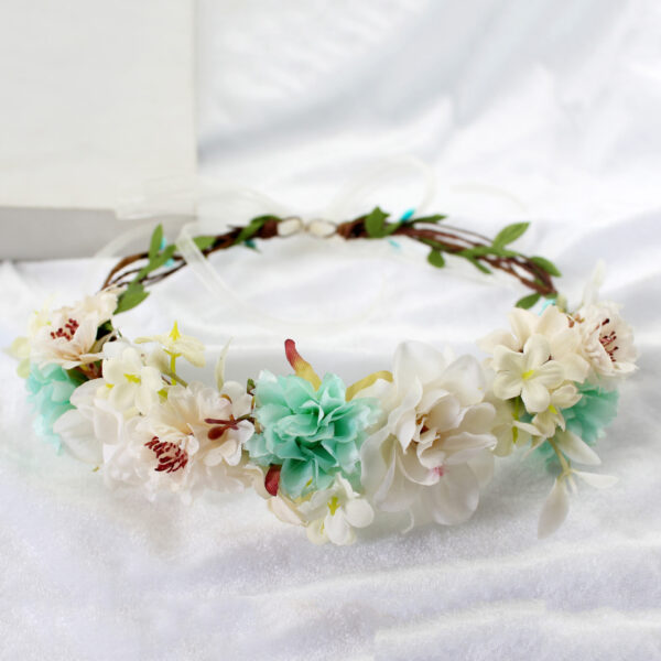 This beautiful flower crown will add a nice touch to your outfit.The crown is very romantic and beautiful.It is made with artificial flowers and greenery.
