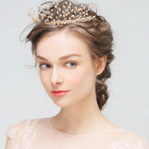 Bridal crown is one of our most exquisite and exclusive designs. It is intricately hand-wired with a spectacular array of pearls, crystals and gold accessories.