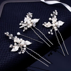 These elegant bridal hair pins are handcrafted with fine quality ivory porcelain flowers, sparkling crystals and luminous pearls.