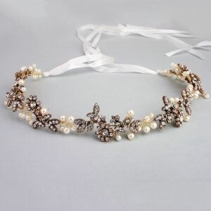 A glorious bridal headband featuring lavish pearls, sparkling crystals and leaves. This luxurious headpiece can be worn with a little height as a classic tiara or flatter across the crown as a headband.
