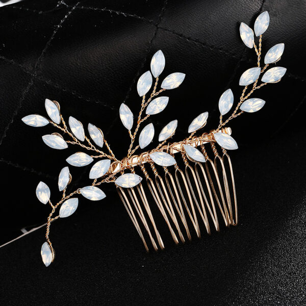 This lovely hair comb is so delicate with sprigs of sparkly cubic zirconia stones.