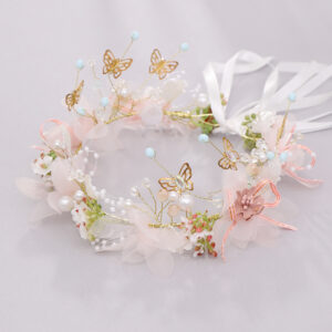 This beautiful flower crown is made from silk paper flowers, artificial greens and butterflies. The two ends join in the back with long, ivory satin ribbon so it fits to any size.